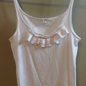 Fitted white camisole with ruffle.